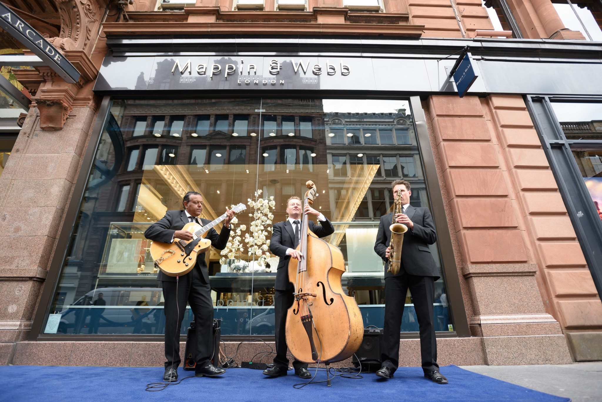 The Ritz Trio perform outside Mappin & Webb Glasgow